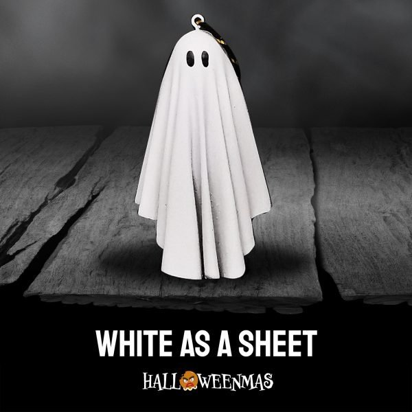 Photo of halloween ornament with sheet with two holes for eyes