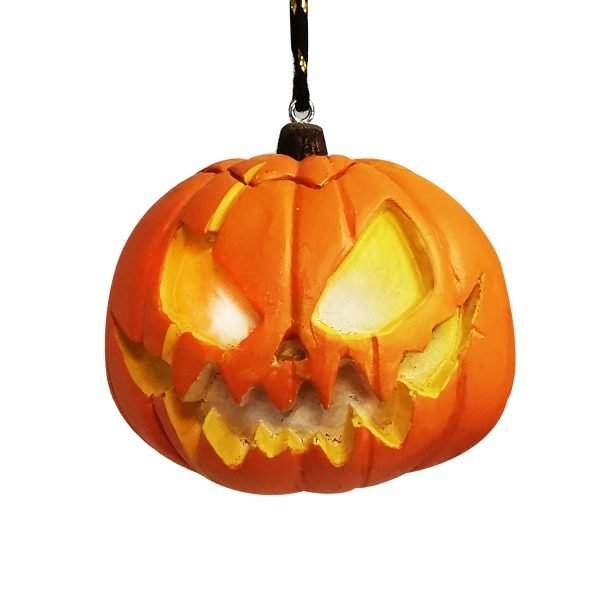 Photo of halloween ornament with pumpkin with glowing eyes