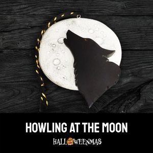 Photo of halloween ornament with wolf silhouette on a white moon
